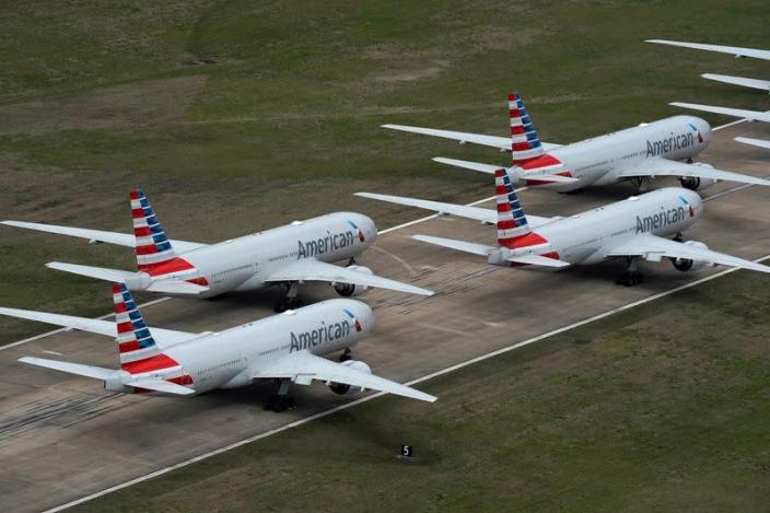 FILE PHOTO: American Airlines passenger planes crowd a runway where they are parked due to flight reductions to slow the spread of coronavirus disease (COVID-19), at Tulsa International Airport in Tulsa