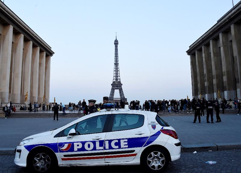 Candidates in the French presidential election have clashed over how to protect France since a policeman was shot dead in Paris
