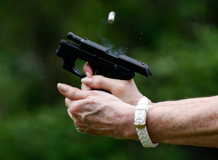 In this April 30, 2016, photograph, a spent round is ejected from a participant's handgun during a concealed carry class in Petal, Mississippi.