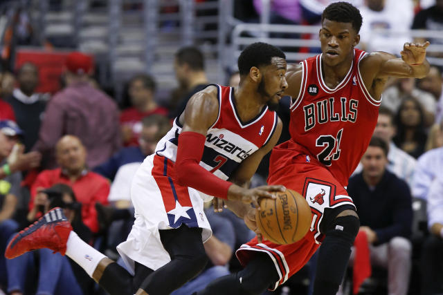 Washington Wizards forward Al Harrington (7) drives past Chicago Bulls guard Jimmy Butler (21) during the first half of Game 4 of an opening-round NBA basketball playoff series in Washington, Sunday, April 27, 2014. (AP Photo/Alex Brandon)