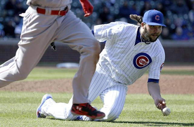 Chicago Cubs relief pitcher James Russell throws out Cincinnati Reds' Billy Hamilton at first base during the ninth inning of a baseball game in Chicago, Friday, April 18, 2014. (AP Photo/Nam Y. Huh)
