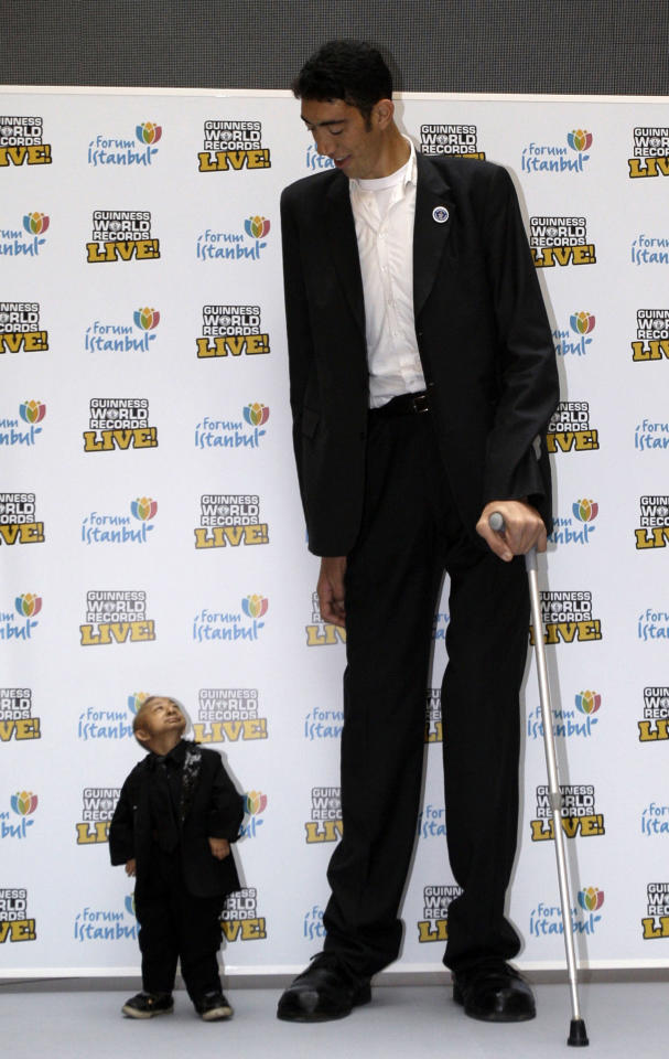 ** FOR USE AS DESIRED, YEAR END PHOTOS ** FILE -In this Jan. 14, 2010 file photo, Sultan Kosen of Turkey, 27, right, and He Pingping of China, 21, seen, during an event organized by the Guinness World Records in Istanbul, Turkey. When the image was taken, the towering Turk, Kosen, is the tallest man walking the planet with a height of 246.5 cm ( 8 feet 1 inch) and He is officially the world's shortest man with a height of 73 cm (2 feet 5 inch).