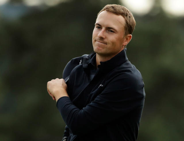 Jordan Spieth reacts after putting on the 18th hole during the fourth round at the Masters golf tournament Sunday, April 8, 2018, in Augusta, Ga. (AP Photo/Chris Carlson)