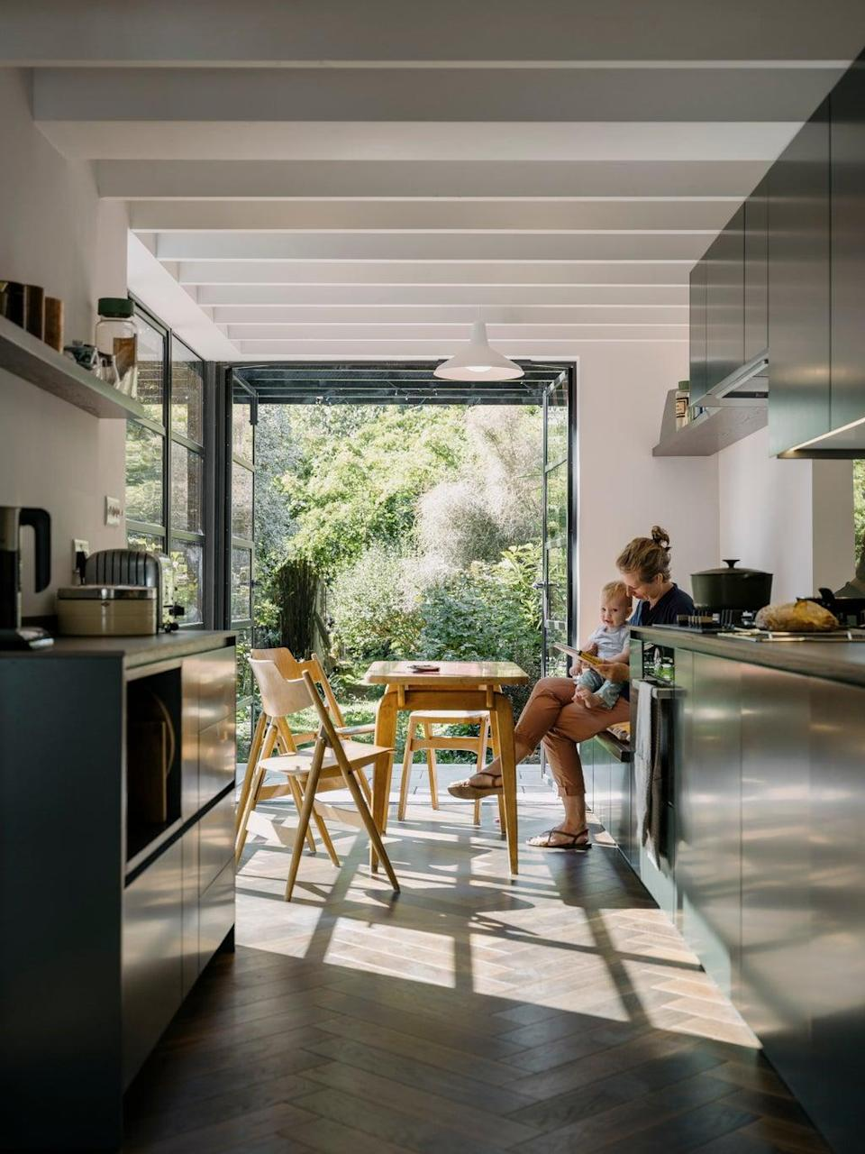 Architect Joanna Coleman admires her own handiwork in the light of the newly opened kitchen-diner (Tim Crocker)