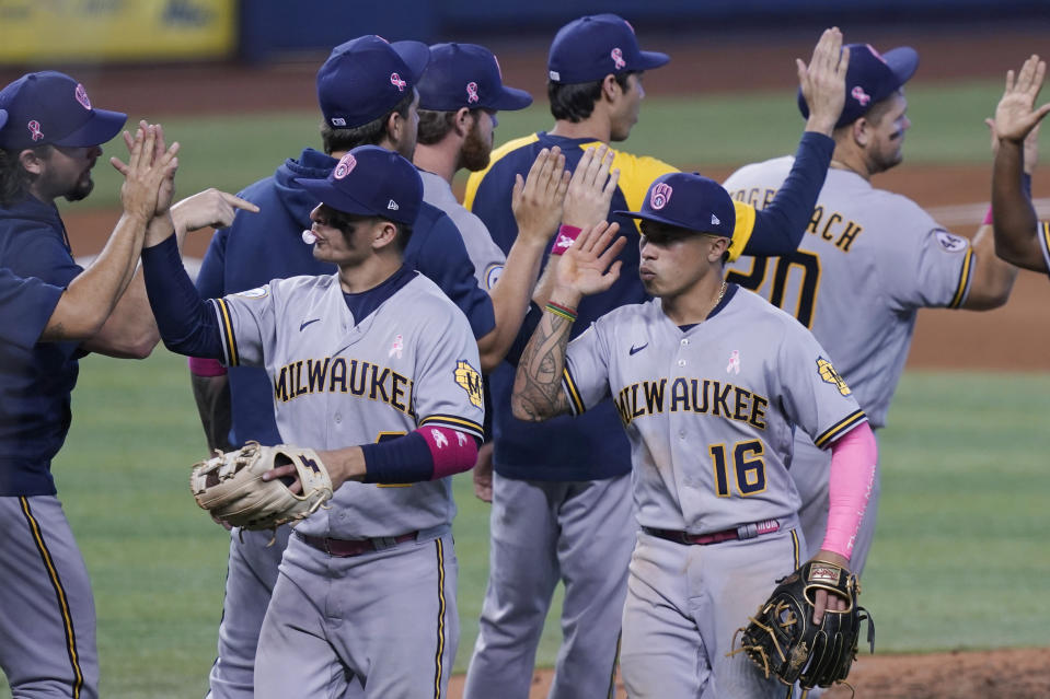 Milwaukee Brewers celebrate their win in 10 innings of a baseball game against the Miami Marlins, Sunday, May 9, 2021, in Miami. (AP Photo/Marta Lavandier)