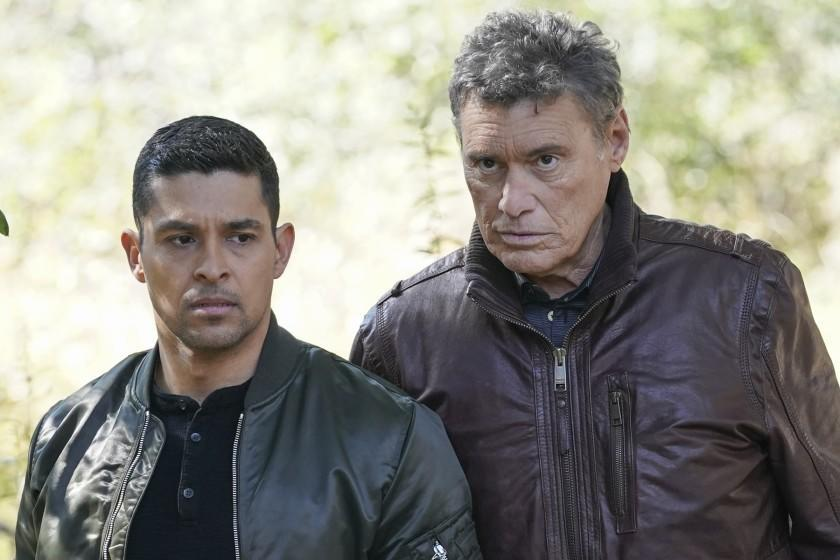"""NCIS -- CBS TV Series, """"Sangre"""" – Evidence from the stabbing of a Marine Sergeant leads Torres to meet his father, Miguel (Steven Bauer), who left when he was a child, on NCIS, Tuesday, April 20 (8:00-9:00 PM, ET/PT) on the CBS Television Network. Pam Dawber returns as investigative reporter Marcie Warren. Pictured: Wilmer Valderrama as NCIS Special Agent Nicholas """"Nick"""" Torres, Steven Bauer as Miguel. Photo: Sonja Flemming/CBS ©2021 CBS Broadcasting, Inc. All Rights Reserved. Wilmer Valderrama, left, and Steven Bauer in """"NCIS"""" on CBS."""