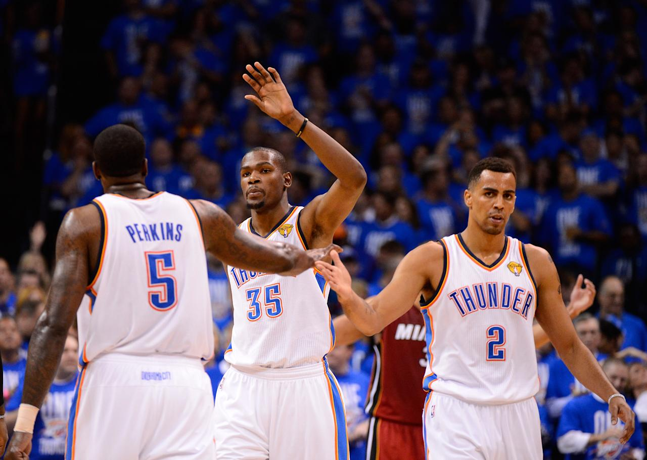 OKLAHOMA CITY, OK - JUNE 12:  (R-L) Thabo Sefolosha #2, Kevin Durant #35 and Kendrick Perkins #5 of the Oklahoma City Thunder celebrate a play in the third quarter while taking on the Miami Heat in Game One of the 2012 NBA Finals at Chesapeake Energy Arena on June 12, 2012 in Oklahoma City, Oklahoma. NOTE TO USER: User expressly acknowledges and agrees that, by downloading and or using this photograph, User is consenting to the terms and conditions of the Getty Images License Agreement.  (Photo by Ronald Martinez/Getty Images)