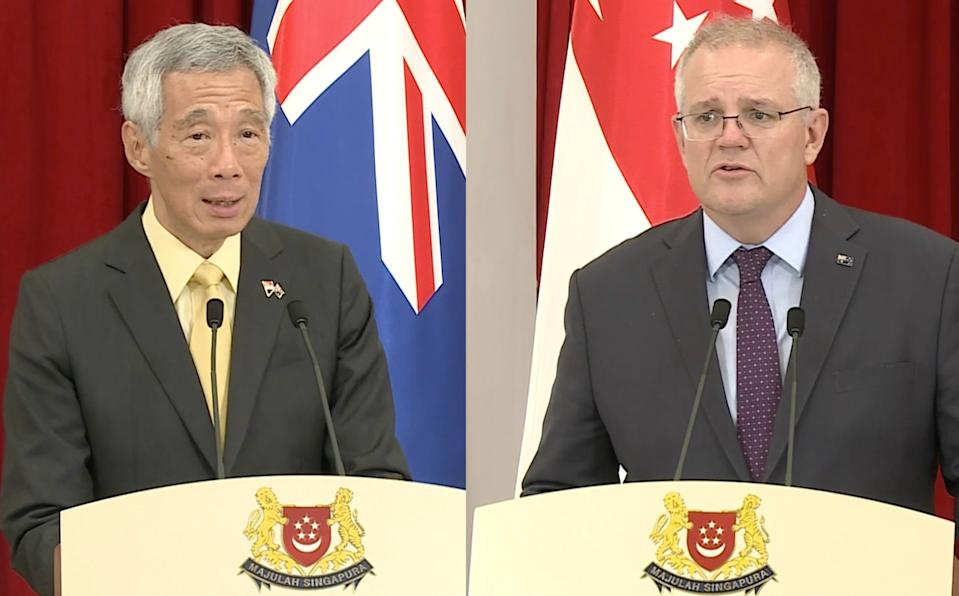 Singapore Prime Minister Lee Hsien Loong and Australian PM Scott Morrison delivering their opening statements at a media conference after their meeting at the Istana on 10 June 2021. (SCREENSHOTS: Facebook/Prime Minister's Office)