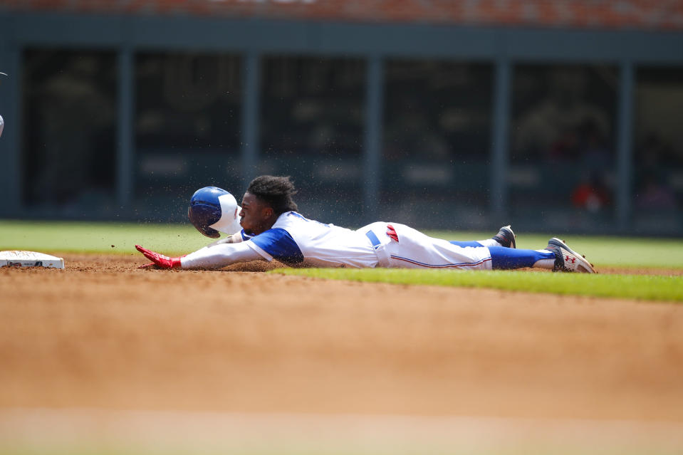 Atlanta Braves' Ozzie Albies steals second base in the third inning of a baseball game against the Baltimore Orioles, Sunday, June 24, 2018, in Atlanta. (AP Photo/Todd Kirkland)