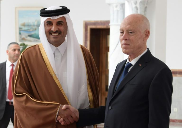 Qatar's emir is in the midst of a diplomatic offensive, here meeting Tunisia's new President Kais Saied, as he seeks to shore up alliances and forge new ones in the face of nearly three years of Saudi-led boycott (AFP Photo/Fethi Belaid)