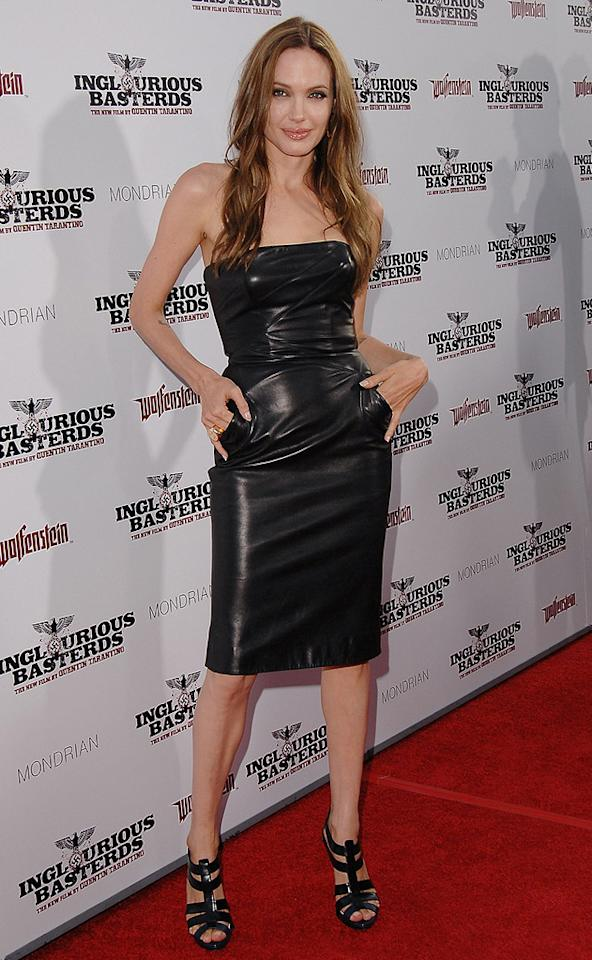 """9. <a href=""""http://movies.yahoo.com/movie/1808404206/info"""">Inglourious Basterds</a> LA premiere (2009)   Brad's better half rocked the red carpet at the premiere of """"Inglourious Basterds"""" in a $1,600 black leather Michael Kors masterpiece, which she paired with strappy Christian Dior stilettos."""