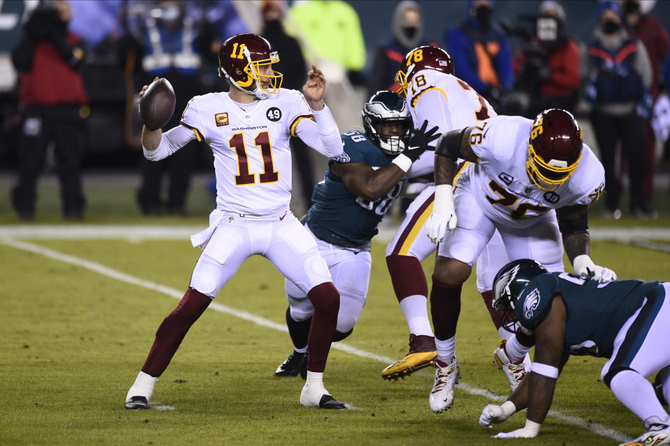 Washington Football Team's Alex Smith plays during the first half of an NFL football game against the Philadelphia Eagles, Sunday, Jan. 3, 2021, in Philadelphia. Alex Smith is the biggest reason Washington became the first team in the Super Bowl era to start 2-7 and make the playoffs. The 36-year-old's journey back from a broken leg and 17 surgeries was a long one, but the difference with him at quarterback has been simple: Smith doesn't make major mistakes, manages the game and is the cool hand coach Ron Rivera wanted in control of his young team. (AP Photo/Derik Hamilton, File)
