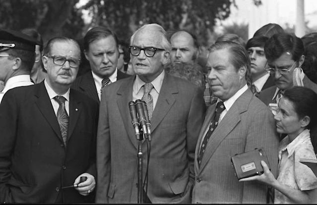 Sen. Barry Goldwater, R-Ariz., center, accompanied by Senate Republican leader Hugh Scott, R-Pa., left, and House GOP leader John Rhodes, R-Ariz., right, speaks to reporters after meeting with President Nixon at the White House in 1974 to discuss Nixon's decision on resigning. (Photo: AP)