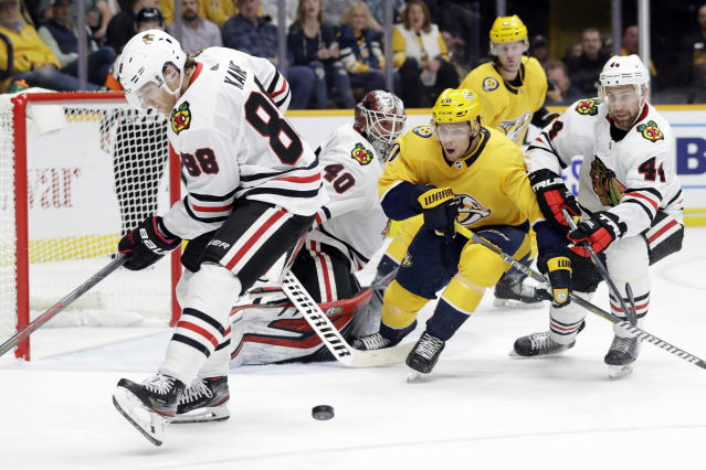 Chicago Blackhawks right wing Patrick Kane (88) and defenseman Calvin de Haan (44) chase the puck with Nashville Predators right wing Miikka Salomaki (20), of Finland, during the second period of an NHL hockey game Tuesday, Oct. 29, 2019, in Nashville, Tenn. (AP Photo/Mark Humphrey)
