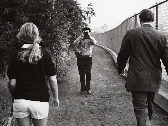 Ron Galella is seen photographing Caroline Kennedy and a Secret Service Agent