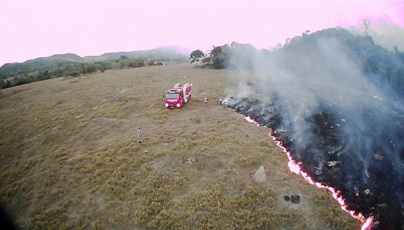 In this Aug. 20, 2019, drone photo released by the Corpo de Bombeiros de Mato Grosso, brush fires burn in Guaranta do Norte municipality, Mato Grosso state, Brazil. Brazil's National Institute for Space Research, a federal agency monitoring deforestation and wildfires, said the country has seen a record number of wildfires this year.