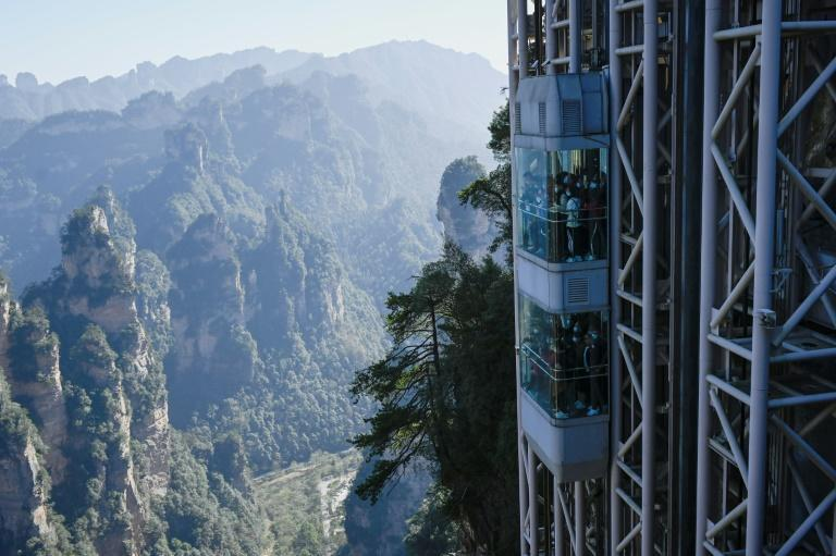 "Located in China's Zhangjiajie Forest Park, the world's highest outdoor lift carries tourists up the cliff face that inspired the landscape for the movie ""Avatar"""
