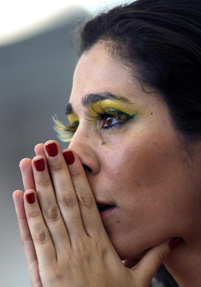 A Brazilian fan watches the penalty shoot-out of the Brazil match prior to the World Cup round of 16 soccer match between Colombia and Uruguay at the Maracana Stadium in Rio de Janeiro, Brazil, Saturday, June 28, 2014. (AP Photo/Themba Hadebe)