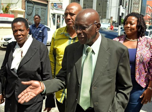 Former FIFA vice-president Jack Warner arrives at the Port-of-Spain Magistrates court for the extradition hearing against him, on September 25, 2015 (AFP Photo/Alva Viarruel)