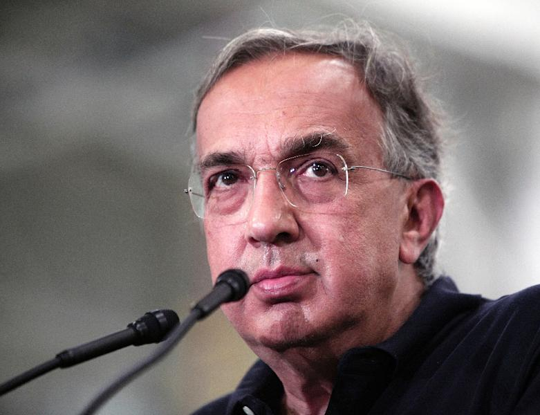 Fiat Chrysler Automobiles CEO Sergio Marchionne answers questions from the media at the FCA Sterling Stamping Plant in Sterling Heights, Michigan, in August 2016 (AFP Photo/Bill Pugliano)