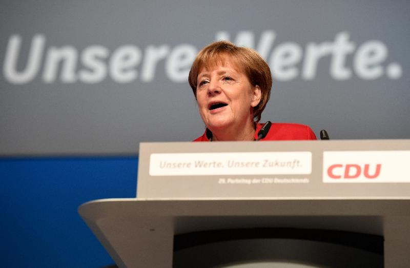 Chancellor Angela Merkel's government decided after Japan's 2011 Fukushima reactor meltdowns to halt operations of Germany's eight oldest nuclear plants and to shutter the other nine by 2022 (AFP Photo/Patrik Stollarz)