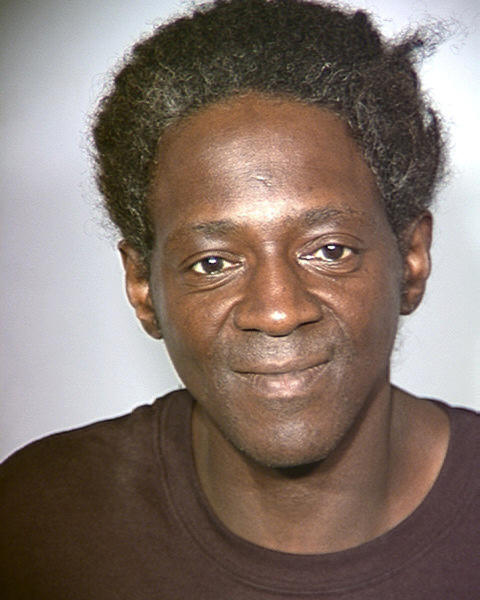 FILE - This police booking file photo released May 2, 2011 by the Las Vegas Police Department, shows rapper and reality television star Flavor Flav after his arrest on four outstanding misdemeanor warrants for driving offenses. Entertainer Flavor Flav has a scheduling conflict between a court date Thursday April 18, 2013, in Las Vegas and his induction with the rap group Public Enemy into the Rock and Roll Hall of Fame in Los Angeles. (AP Photo/Las Vegas Police Department, file)