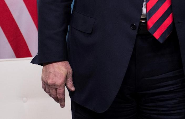Macron turned part of Trump's hand pale with a blood-squeezing grip when they met (AFP Photo/SAUL LOEB)