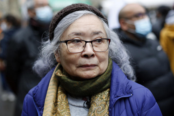 Tran To Nga, a 78-year-old former journalist, attends a gathering in support of people exposed to Agent Orange during the Vietnam War, in Paris, Saturday Jan. 30, 2021. Activists gathered Saturday in Paris in support of people exposed to Agent Orange during the Vietnam War, after a French court examined a case opposing a French-Vietnamese woman to 14 companies that produced and sold the toxic chemical. (AP Photo/Thibault Camus)