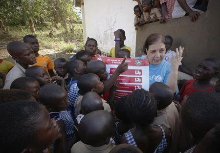 United Nations Children's Fund (UNICEF) Ivory Coast Representative Adele Khudr speaks to children during an Ebola awareness drive in Toulepleu