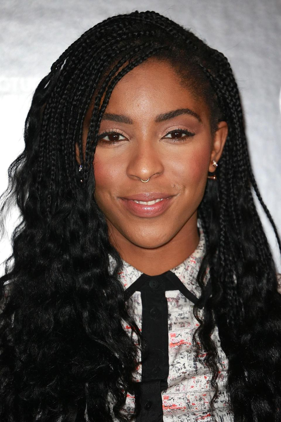 The next time you're switching up a protective style, try undoing your braids halfway like Jessica Williams.