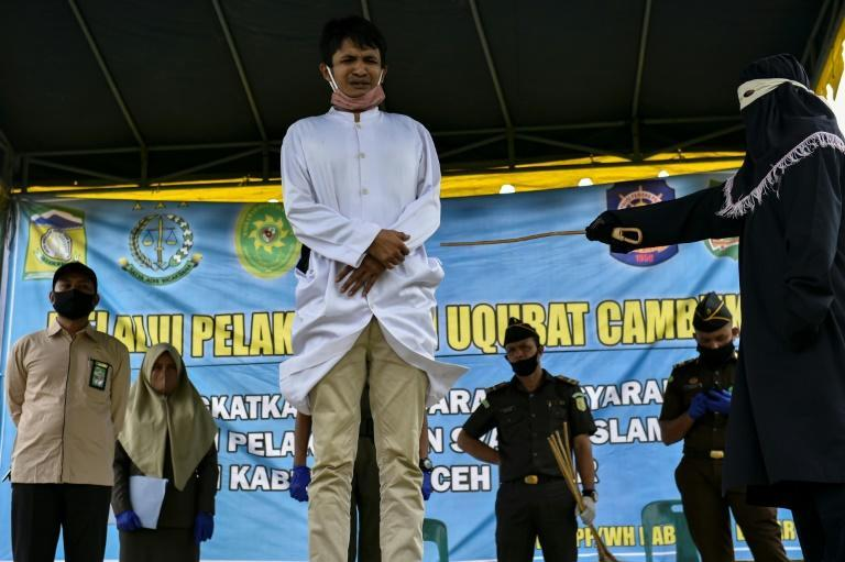 Dozens watched Friday's flogging, a spectacle criticised by rights groups but which regularly attracted hundreds before the pandemic (AFP Photo/CHAIDEER MAHYUDDIN)