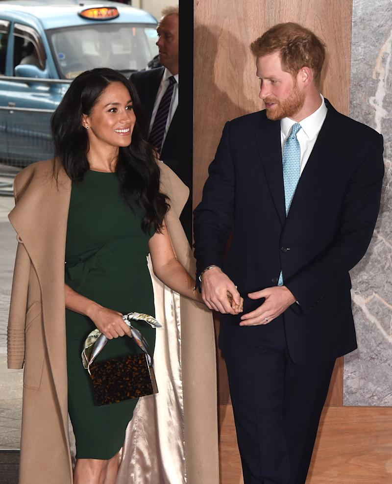 Meghan debuted a new trendy handbag at the awards. [Photo: Getty]
