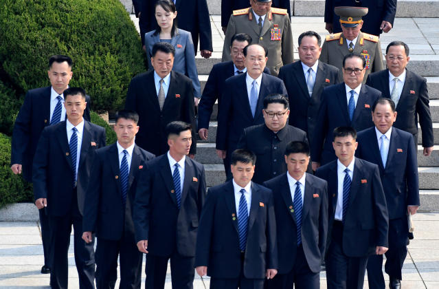 <p>North Korean leader Kim Jong Un, center, is surrounded by his security guards upon his arrival for a meeting with South Korean President Moon Jae-in at the North Korea side of Panmunjom in the Demilitarized Zone, South Korea, Friday, April 27, 2018. (Photo: Korea Summit Press Pool via AP) </p>