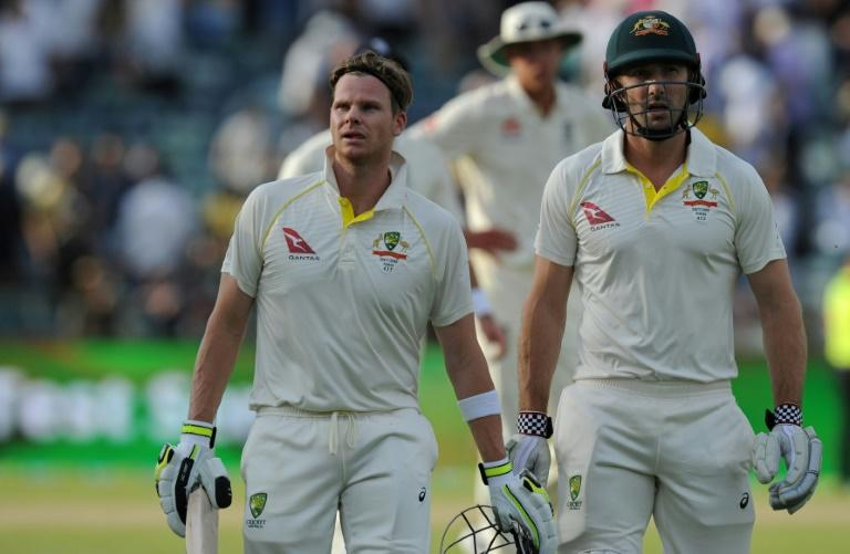 Australia captain Steve Smith (front-L) and teammate Shaun Marsh leave the field at the end of play on day two of the third Ashes Test in Perth on December 15, 2017