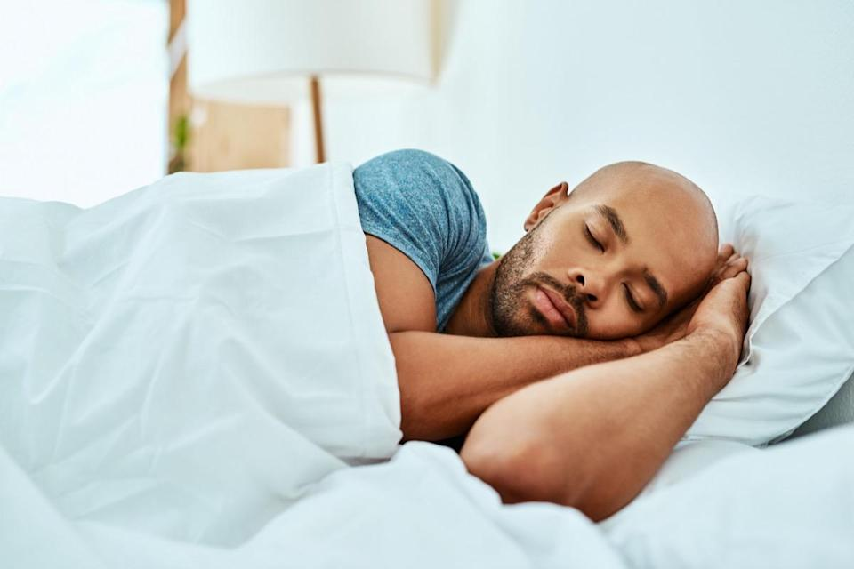 """Going to bed just a little bit earlier might make all the difference when it comes to the health of your heart. According to a 2019 study of 3,974 adult participants published in the <em>Journal of the American College of Cardiology</em>, getting under six hours of sleep can <a href=""""https://pubmed.ncbi.nlm.nih.gov/30654884/"""" rel=""""nofollow noopener"""" target=""""_blank"""" data-ylk=""""slk:increase a person's heart disease risk"""" class=""""link rapid-noclick-resp"""">increase a person's heart disease risk</a> by as much as 27 percent. So hitting the hay even just half an hour earlier can push you into healthier territory."""