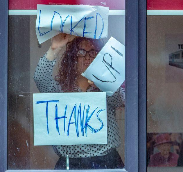Signs posted on a window at Manchester Metropolitan University's Birley campus, on Monday