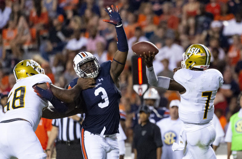 FILE - In this Sept. 8, 2018, file photo, Auburn defensive lineman Marlon Davidson (3) pressures Alabama State quarterback Darryl Pearson, Jr. (7) during the first half of an NCAA college football game, in Auburn, Ala. Davidson returns to a defense rthat still figures to be formidable. (AP Photo/Vasha Hunt, File)