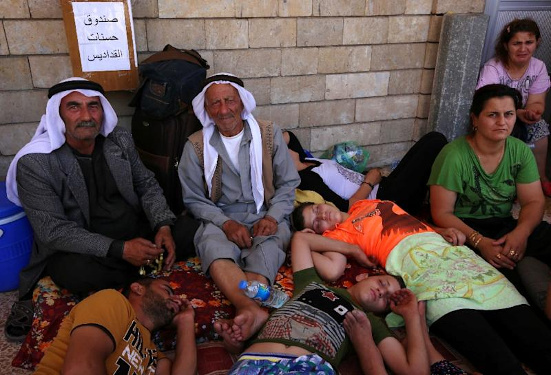 Iraqi Christians who fled the violence in the village of Qaraqush, east of the northern province of Nineveh, rest upon their arrival at the Saint-Joseph church in the Kurdish city of Arbil, on August 7, 2014 (AFP Photo/Safin Hamed)