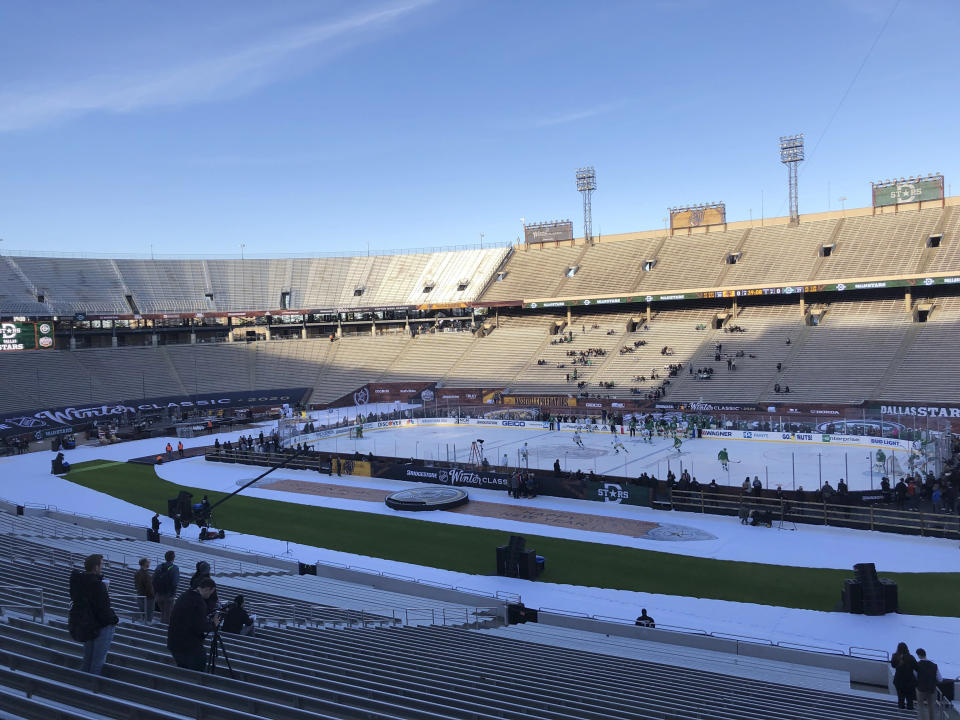 The Dallas Stars get their first time on the ice for practice, Tuesday, Dec. 31, 2019, a day before the NHL hockey Winter Classic game against the Nashville Predators at the Cotton Bowl Stadium in Dallas. (AP Photo/Stephen Hawkins)