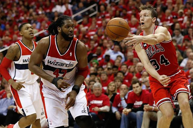 WASHINGTON, DC - APRIL 25: Mike Dunleavy #34 of the Chicago Bulls passes the ball past Nen #42 of the Washington Wizards in fourth quarter action of Game 3 of the Eastern Conference Quarterfinals during the 2014 NBA Playoffs at the Verizon Center on April 25, 2014 in Washington, DC. Chicago won the game 100-97. (Photo by Win McNamee/Getty Images)