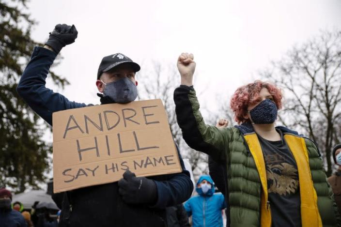 Protesters gather after the killing of Andre Maurice Hill in Columbus, Ohio