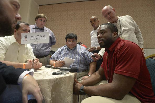 Boston College running back Andre Williams, right, answers questions during a media availability prior to the College Football Awards show in Lake Buena Vista, Fla., Wednesday, Dec. 11, 2013. (AP Photo/Phelan M. Ebenhack)