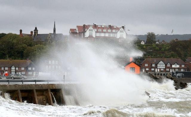 Waves hit the harbour wall in Folkestone, Kent
