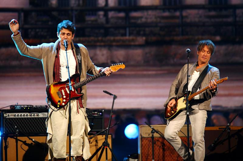John Mayer, left, and Keith Urban perform at the night that changed America: a Grammy salute to the Beatles, on Monday, Jan. 27, 2014, in Los Angeles. (Photo by Zach Cordner/Invision/AP)