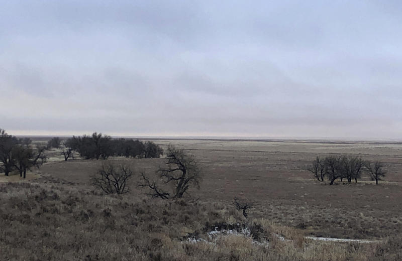 In this Dec. 27, 2019, photo, the site that was once home to a Native American village is shown at the Sand Creek Massacre National Historic Site in Eads, Colo. This quiet piece of land tucked away in rural southeastern Colorado seeks to honor the 230 peaceful Cheyenne and Arapaho tribe members who were slaughtered by the U.S. Army in 1864. It was one of worst mass murders in U.S. history. (AP Photo/Russell Contreras)