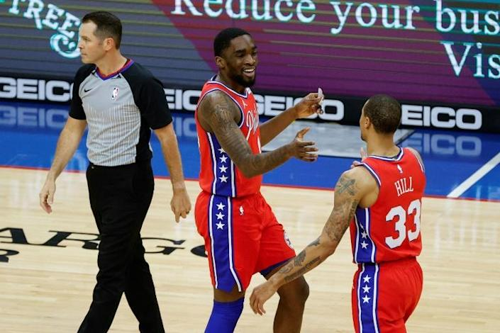 Philadelphia's Shake Milton and George Hill celebrate a shot in the 76ers' 122-97 NBA victory over the Orlando Magic