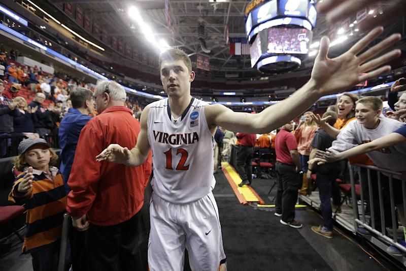 Virginia guard Joe Harris (12) slaps the hands of fans after the second half of an NCAA college basketball third-round tournament game against Memphis, Sunday, March 23, 2014, in Raleigh, N.C. Virginia won 78-60. (AP Photo/Chuck Burton)
