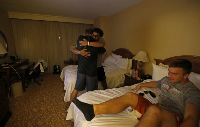 Texas Longhorns head coach Tom Herman hugs players Casey Thompson (left) and Sam Ehlinger goodnight Friday Sept. 6, 2019 at the team hotel in Austin, Tx. ( Photo by Edward A. Ornelas )