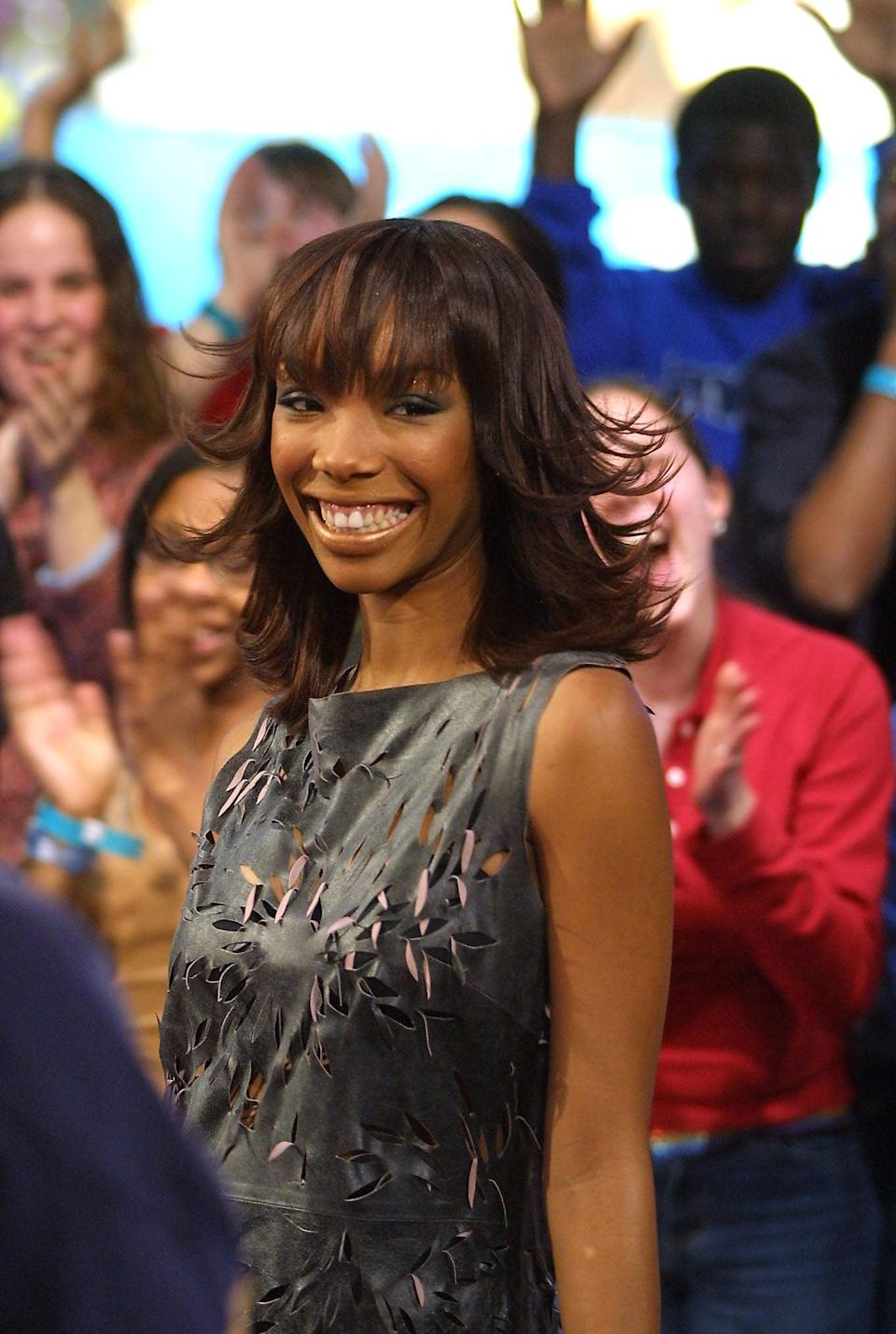 <p>Brandy was all smiles during her <b>TRL</b> appearance in 2002.</p>