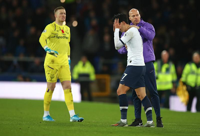 LIVERPOOL, ENGLAND - NOVEMBER 03: Son Heung-min of Tottenham Hotspur looks on in horror after a tackle on Andre Gomes of Everton which resulted in a red card and Gomes suffering an injury during the Premier League match between Everton FC and Tottenham Hotspur at Goodison Park on November 3, 2019 in Liverpool, United Kingdom. (Photo by Robbie Jay Barratt - AMA/Getty Images)